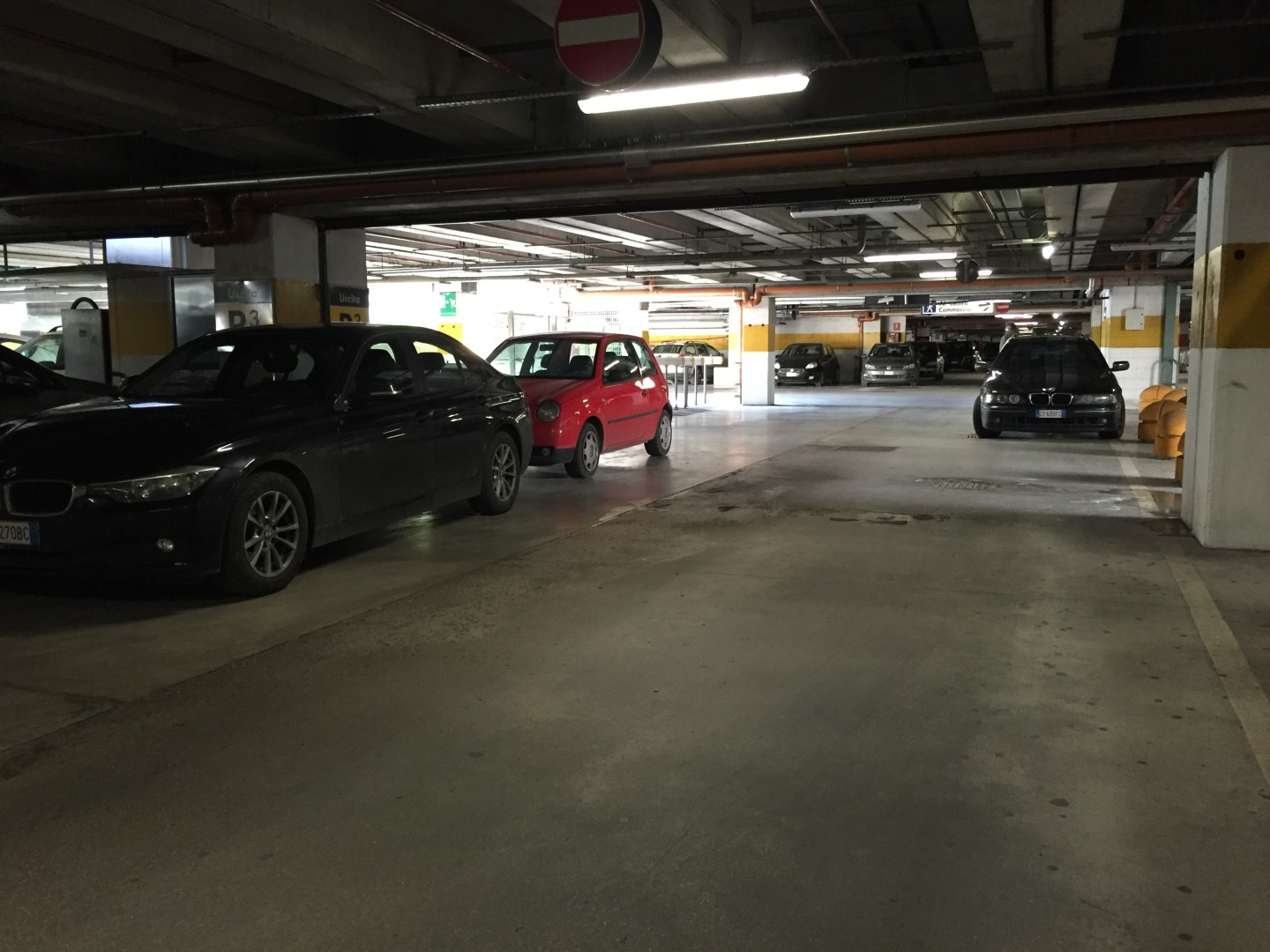 All the cars here are parked. The driver of the car on the right obviously could not walk. The drivers of the cars on the left also made their own spaces in this garage.